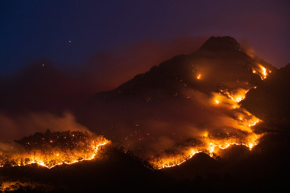 Border Fire Mount Barney. A slow moving fire sweeps across the ridges of Mt Barney during the 2019 fire season in Australia.