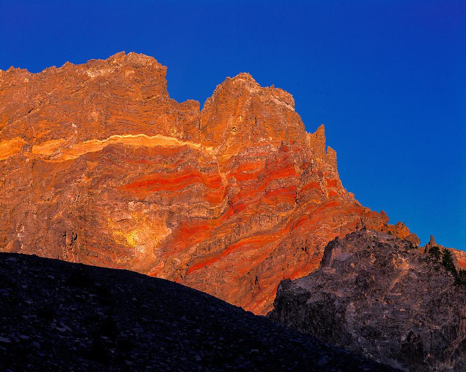 Up close, the striations of Three Fingered Jack take on a reddish-orange hue, Cascade Range, Oregon. ©Ric Ergenbright