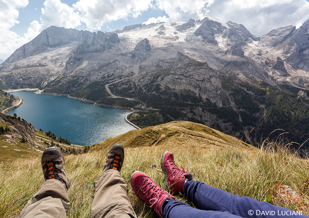 Resting place along the Viel del Pan route with view on Marmolada Glacier and Fedaia Lake.