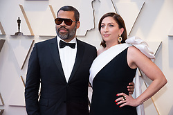 Jordan Peele, Oscar® nominee, and Chelsea Peretti arrive on the red carpet of The 91st Oscars® at the Dolby® Theatre in Hollywood, CA on Sunday, February 24, 2019.