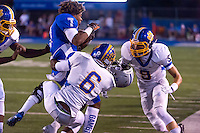 Rocklin High School Thunder's, Kier Gibson-adams (7), losses his helmet as he is tackled as the Rocklin Thunder host the Del Campo Cougars, Friday September 4, 2015.<br /> Brian Baer/Special to the Bee