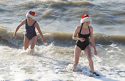 Christmas Day Swim on Brighton Beach 11am on 25th December 2014 <br /> Brighton Sea Front, Brighton, East Sussex, Great Britain <br /> <br /> <br /> Swimming on Christmas Day on Brighton beach defying orders from Brighton & Hove Council not to swim on Christmas Day.<br /> <br /> <br /> <br /> Photograph by Elliott Franks <br /> Image licensed to Elliott Franks Photography Services