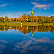 www.aziznasutiphotography.com                               This absolutely beautiful view from Nidelva, Elgeseter Bru and nidaros cathedral and gamlebybro in Trondheim in the autumn.