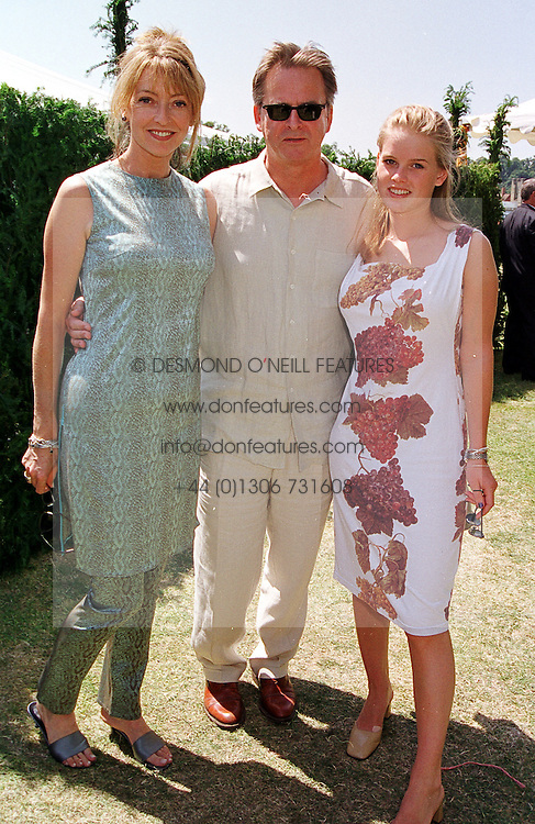 Left to right, actress SHARON MAUGHAN, her husband actor TREVOR EVE and their daughter MISS ALICE EVE, at a polo match in West Sussex on 18th July 1999.MUH 31