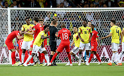 Referee Mark Geiger shows Colombia's Carlos Sanchez (fifth left) a yellow card after a foul on England's Harry Kane during the FIFA World Cup 2018, round of 16 match at the Spartak Stadium, Moscow.
