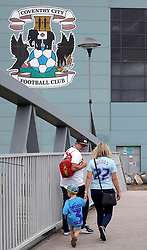 Fans make their way to the Ricoh Arena ahead of the Sky Bet League One match