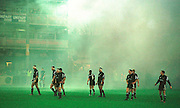 Gloucester, United Kingdom 20001223 Gloucester v Newcastle Premiership,  Newcastle, wait to start the game, shrouded in smoke from the pre game fire work display. [Mandatory Credit, Peter Spurrier/ Intersport Images] Played At Gloucester's Kingsholm Ground.
