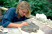 Artist age 32 making lizard at the Landscape Arboretum.  Chanhassen  Minnesota USA