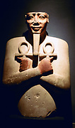 Statue of Egyptian pharaoh Tuthmosis III (1479-1447) at Luxor: 18th Dynasty. Note Ankhs held over his chest. The Ankh was the Egyptian symbol of life.