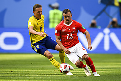 July 3, 2018 - Saint Petersburg, Russia - Xherdan Shaqiri of Switzerland controls the ball with Ludwig Augustinsson of Sweden during the 2018 FIFA World Cup Round of 16 match between Sweden and Switzerland at Sankt Petersburg Stadium in Sankt Petersburg, Russia on July 3, 2018  (Credit Image: © Andrew Surma/NurPhoto via ZUMA Press)