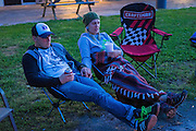 Emily and Dirk Mathews relax after the first day of riding at the 2016 Hillbilly Dual Sport ride in Marble Falls, AR.