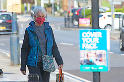 © Licensed to London News Pictures 18/05/2021.  Sevenoaks, UK. A woman wearing a mask in Sevenoaks High Street in Kent today as the Indian Covid strain has been detected in parts of the county. According to local media reports up to twenty cases have been recorded in one week in Kent. Photo credit:Grant Falvey/LNP