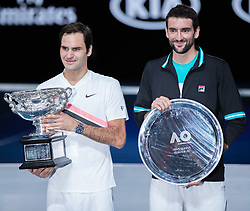 MELBOURNE, Jan. 28, 2018  Switzerland's Roger Federer(L) and Croatia's Marin Cilic hold their trophies during the awarding ceremony of the men's singles final match at Australian Open 2018 in Melbourne, Australia, Jan. 28, 2018. (Credit Image: © Zhu Hongye/Xinhua via ZUMA Wire)