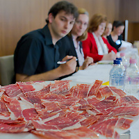 Members of the jury judge a competitor during the first ever ham slicing competition in Budapest, Hungary on May 9, 2012. ATTILA VOLGYI