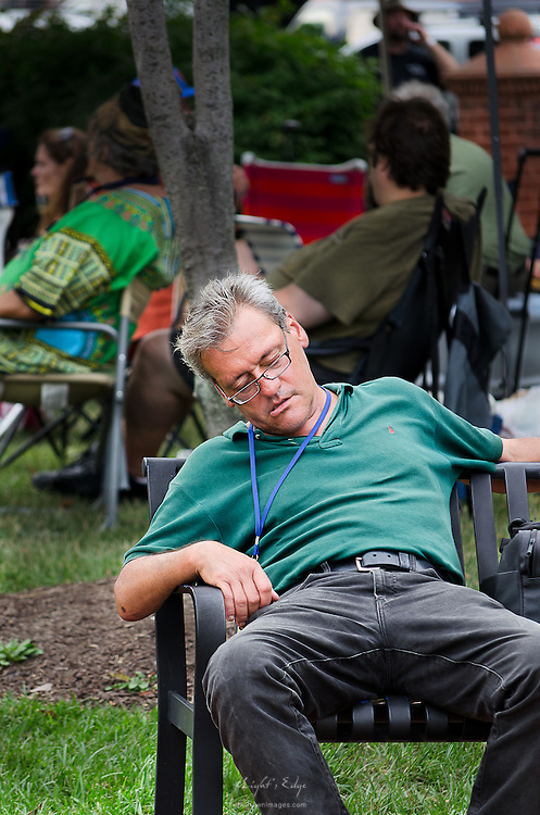 The heat of the day seems to have taken its toll on this concert goer.