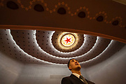 An attendant stands inside the Great Hall of the People on the closing day of the 12th National Peoples Congress NPC in Beijing, China, on Wednesday, March 16, 2016.