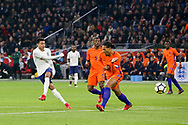 England midfielder Jesse Lingard shoots at goal past Netherlands Defender Virgil van Dijk (Liverpool) during the Friendly match between Netherlands and England at the Amsterdam Arena, Amsterdam, Netherlands on 23 March 2018. Picture by Phil Duncan.