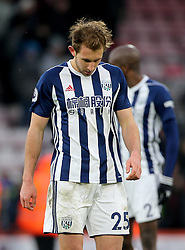 """West Bromwich Albion's Craig Dawson appears dejected after the final whistle during the Premier League match at the Vitality Stadium, Bournemouth. PRESS ASSOCIATION Photo. Picture date: Saturday March 17, 2018. See PA story SOCCER Bournemouth. Photo credit should read: Mark Kerton/PA Wire. RESTRICTIONS: EDITORIAL USE ONLY No use with unauthorised audio, video, data, fixture lists, club/league logos or """"live"""" services. Online in-match use limited to 75 images, no video emulation. No use in betting, games or single club/league/player publications."""