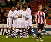 Photo: Steve Bond.<br /> Sheffield United v Arsenal. Carling Cup. 31/10/2007. Eduardo (obscured) is congratulated