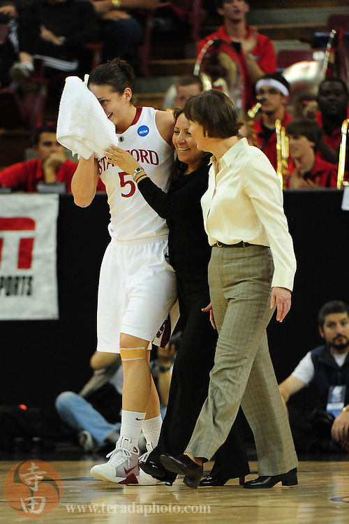 March 27, 2010; Sacramento, CA, USA; Stanford Cardinal forward Michelle Harrison (5) receives medical treatment from athletic trainer Marcella Shorty (center) and head coach Tara VanDerveer (right) during the 2010 NCAA Division I Women's Basketball Sacramento Regional Sweet 16 game against the Georgia Bulldogs at Arco Arena. The Cardinal defeated the Bulldogs 73-36. Mandatory Credit: Kyle Terada-Terada Photo