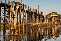 U BEIN BRIDGE, MYANMAR - NOVEMBER 28, 2016 : fisherman fishing U Bein Bridge Taungthaman Lake Amarapura  Mandalay state Myanmar (Burma)
