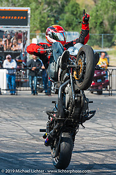 Stunt Rider Cole Freeman performing at the Harley-Davidson downtown Sturgis display during the annual Black Hills Motorcycle Rally. SD, USA. August 9, 2014.  Photography ©2014 Michael Lichter.