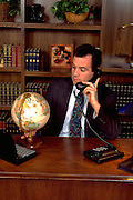 Argentinean businessman age 33 on phone in office.  St Paul Minnesota USA