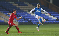 Sammie Szmodics of Peterborough United in action with Scott Leather of Chorley - Mandatory by-line: Joe Dent/JMP - 28/11/2020 - FOOTBALL - Weston Homes Stadium - Peterborough, England - Peterborough United v Chorley - Emirates FA Cup second round