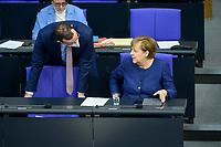 08 DEC 2020, BERLIN/GERMANY:<br /> Jens Spahn (L), CDU, Bundesgesundheitsminister, mit Maske, und Angela Merkel (R), CDU, Bundeskanzlerin, im Gespraech, Haushaltsdebatte, Plenum, Reichstagsgebaeude, Deuscher Bundestag<br /> IMAGE: 20201208-02-026<br /> KEYWORDS: Mund-Nase-Schutz, Corona, Corvid-19, Gespräch, Mundschutz