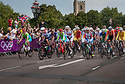 London, UK. Saturday 28th July 2012. On Putney Bridge in London, the peloton of riders led by 2012 Tour de France winner Bradley Wiggins of Team GB (left in blue and white) in the Men's Team Road Race. pass.