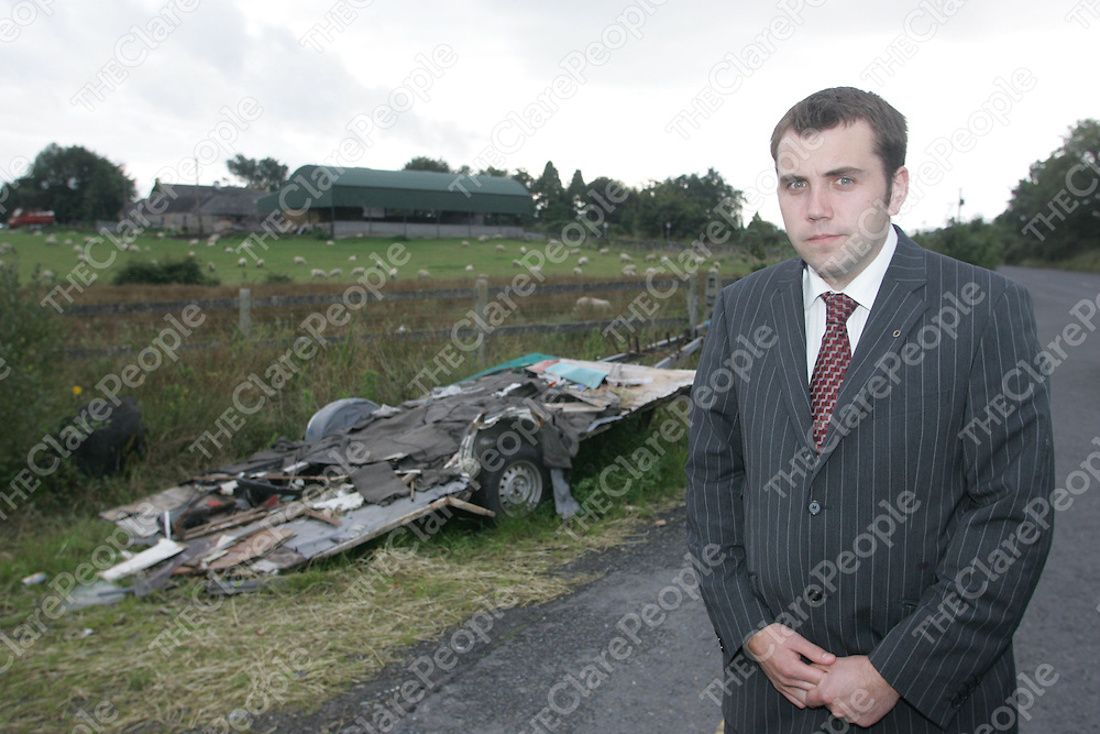 Cllr Cathal Crowe standing next to whats left of a Caravan near Crathloe Co.Clare.<br /> Pic.Brian Gavin/Press 22