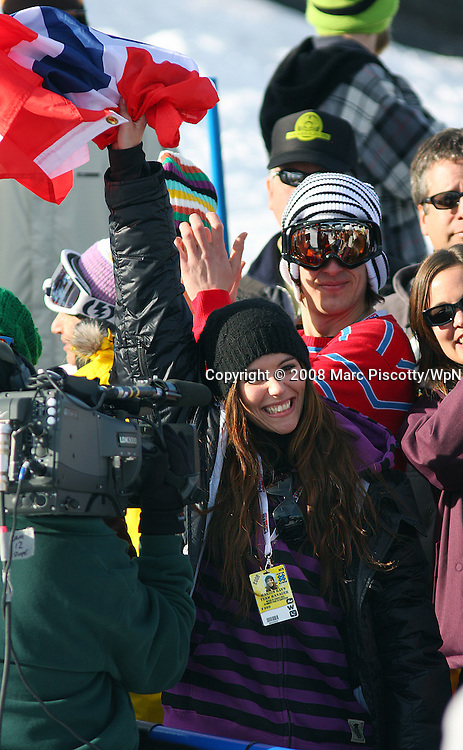 SHOT 1/26/08 3:05:21 PM - Norwegian singer/songwriter Marion Raven (center) cheers boyfriend Andreas Wiig on during the Snowboard Slopestyle finals Saturday January 26, 2008 at Winter X Games Twelve in Aspen, Co. at Buttermilk Mountain. Wiig won the event with a score of 92.00, beating out U.S. riders Kevin Pearce (88.33) and Shaun White (83.33). It was the second year in a row Wiig has won gold in the event. The 12th annual winter action sports competition features athletes from across the globe competing for medals and prize money is skiing, snowboarding and snowmobile. Numerous events were broadcast live and seen in more than 120 countries. The event will remain in Aspen, Co. through 2010..(Photo by Marc Piscotty / WpN © 2008)
