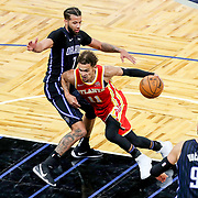 ORLANDO, FL - MARCH 03: Trae Young #11 of the Atlanta Hawks drives to the net past Michael Carter-Williams #7 of the Orlando Magic during the second half at Amway Center on March 3, 2021 in Orlando, Florida. NOTE TO USER: User expressly acknowledges and agrees that, by downloading and or using this photograph, User is consenting to the terms and conditions of the Getty Images License Agreement. (Photo by Alex Menendez/Getty Images)*** Local Caption *** Trae Young; Michael Carter-Williams