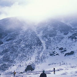 Snowshoers explore Tuckerman Ravine in New Hampshire's White Mountain National Forest.  Mt. Washington. Pinkham's Grant, NH