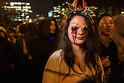 New York, NY, October 31, 2013. A woman made up to look as if her eyes had been recently torn from their sockets in New York's Greenwich Village Halloween Parade.