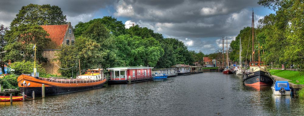 Holland canal with houseboats ships