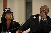 DISTRICT OF COLUMBIA - MARCH 26, 2007:  Former Mayor/City Councilman Marion Barry, right, and President of Standup for Democracy Anise Jenkins listen to comments at an evening town hall meeting in Washington, D.C., concerning poverty in America during a 2007 Initiative conducted by Martin Luther King, III and his nonprofit organization, Realizing the Dream.