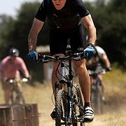 CALABASAS, CA - July 2, 2005:  Mountain biker Mark Langton rides his mountain bike while teaching a introductory mountain biking class at Malibu Creek State Park in the Santa Monica Mountains on July 2, 2005. (Photo by Todd Bigelow/Aurora)
