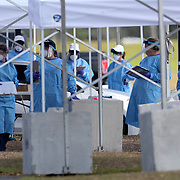 Medical personnel in full personal protective equipment test residents who are aged 65 and over that are concerned  they may have acquired Coronavirus (COVID-19) at the Orange County Convention Center on Friday, March 27, 2020 in Orlando, Florida. (Alex Menendez via AP)