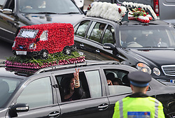 **2018 Pictures of the year by London News Pictures**<br /> © Licensed to London News Pictures. 03/05/2018. Swanley, UK. A woman gestures from a car window as Police watch as The funeral procession of burglar Henry Vincent leave Swanley to head to a service in St Mary Cray, Bromley, London. Henry Vincent, who is part of a traveller community in the south east London, died during an attempted burglary of the home of pensioner Richard Osborn-Brook in Hither Green. Photo credit: Ben Cawthra/LNP