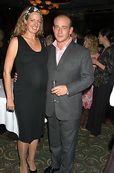 Writer GAY LONGWORTH and her husband ADAM SPIEGEL at a party to celebrate the publication of 'Next To You' - Caron's Courage remembered by her mother Gloria Hunniford held on Caron's birthday at The Hilton Park Lane, London on 5th Octobe 2005.<br /><br />NON EXCLUSIVE - WORLD RIGHTS