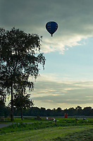 hot air balloon over a rural landscape