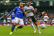 Oldham Athletic forward Gevaro Nepomuceno (27) battles for possession with Fulham forward Floyd Ayite (11) during The FA Cup 3rd round match between Fulham and Oldham Athletic at Craven Cottage, London, England on 6 January 2019.
