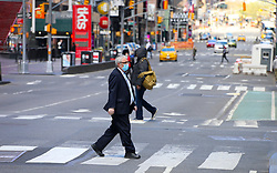 Man with face mask is walking in Times Square during the Covid-19 pandemic in New York City, NY, USA on April 22, 2020. The Big Apple neared a painful milestone Wednesday as the death toll from the coronavirus outbreak that has ravaged the five boroughs approached 15,000. The pandemic has claimed the lives of 14,996 New Yorkers, with new 569 fatalities reported in the most recent 24-hour period, according to data from the city's Department of Health. Photo by Charles Guerin/ABACAPRESS.COM