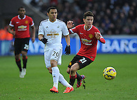 Swansea City's Jefferson Montero vies for possession with Manchester United's Ander Herrera<br /> <br /> Photographer Ashley Crowden/CameraSport<br /> <br /> Football - Barclays Premiership - Swansea City v Manchester United - Saturday 21st February 2015 - Liberty Stadium - Swansea<br /> <br /> © CameraSport - 43 Linden Ave. Countesthorpe. Leicester. England. LE8 5PG - Tel: +44 (0) 116 277 4147 - admin@camerasport.com - www.camerasport.com
