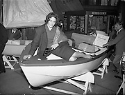 "18/04/1960<br /> 04/18/1960<br /> 18 April 1960<br /> The First Annual Boat Show at  Busaras, Store Street, Dublin.<br /> Just trying it for size is Miss Pasquelle Farrell, Stepaside, Co. Dublin, a maid of the mountains who's thoughts are turning to the seas. ""We found Pasquelle picking a boat for herself at the first National Boat Show which opened in Dublin on Easter Monday. She hopes to join the sport this season"" original caption."