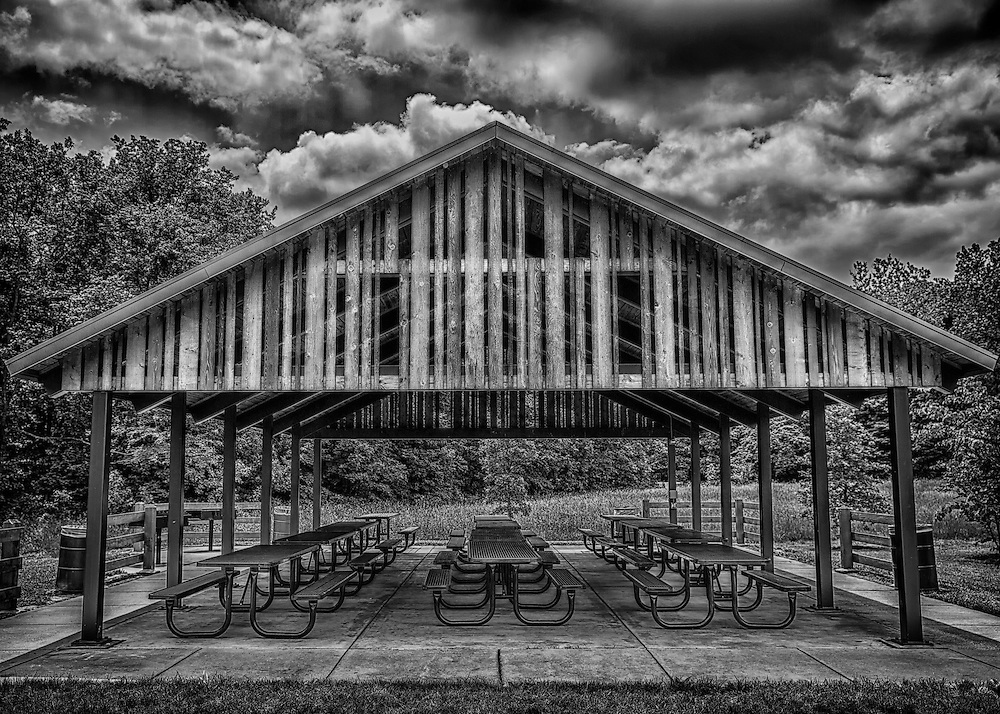 A public pavilion at Broemmelsiek Park in black and white