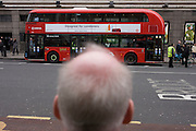 A future passenger admired the shape and lines of London's newest red double-decker Routemaster (27th Feb 2012) bus which is seen in service on the capital's streets for the first time. The hybrid NB4L, or the Borismaster, New Routemaster or Boris Bus, is a 21st century replacement of the iconic Routemaster as a bus built specifically for use in London and is said to be 40 per cent more fuel efficient than conventional diesel buses. The brainchild of London's Conservative mayor Boris Johnson, its funding has been controversial amid massive fare increases in transport.