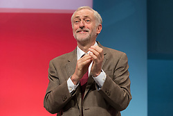 © Licensed to London News Pictures . 29/09/2015 . Brighton , UK . JEREMY CORBYN applauds after delivering his speech to the 2015 Labour Party Conference . Photo credit : Joel Goodman/LNP