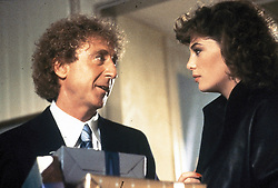 GENE WILDER, (born Jerome Silberman, June 11, 1933 - August 28, 2016) was an American stage and screen comic actor, screenwriter, film director, and author. He was known best for the lead role in the 1971 film 'Willy Wonka in Willy Wonka & the Chocolate Factory,' and the Mel Brooks comedies 'Blazing Saddles', and 'Young Frankenstein', which Wilder co-wrote, garnering the pair an Academy Award nomination for Best Adapted Screenplay. Wilder died at age 83 from complications from Alzheimer's disease. PICTURED: GENE WILDER and KELLY LE BROCK in a scene from the 1984 film 'The Woman In Red.' (Credit image: © Orion Pictures/Entertainment Pictures/ZUMAPRESS.com)